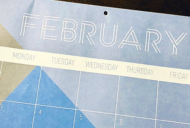 a blue calendar page featuring February
